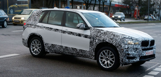 Next Generation 2014 BMW X5 Spotted Peeling Off Some Camo