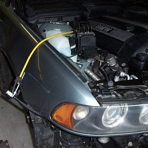 Suspend the headlight washer hose to eliminate syphoning.