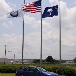 BMW Performance Center Delivery - Right outside the Performance Center with the BMW, USA, and South Carolina state flags.  Also, the BWM factory is in
