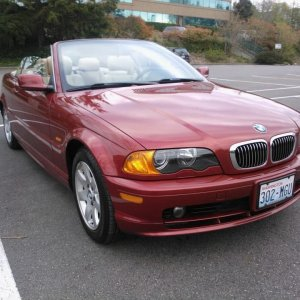 My 2001 BMW 325Ci convertible in Sienna Red and black convertible top.