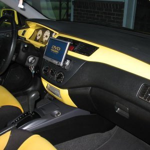 2002 Mistubishi Lancer OZ Rally Edition (blah) I was 17... I now hate yellow to this day. sony in dash, 'glassed DVD player into dash, JL components,