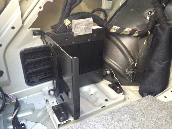 this allowed the oem amp to remain securely mounted, gave space to mount  the new amp, and provided a part of the changer bracket to help mount the  new amp